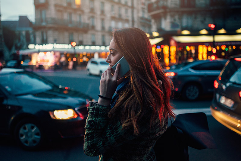 Woman talking on her mobile in the street
